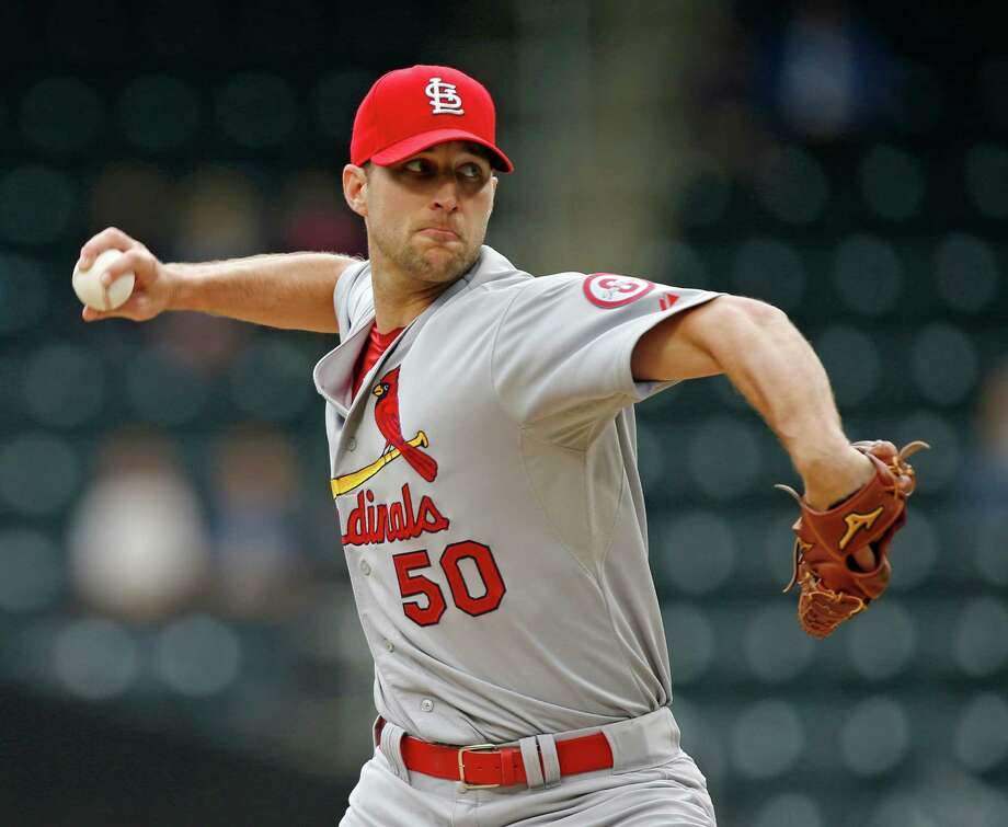 St. Louis Cardinals starting pitcher Adam Wainwright delivers in the first inning of a baseball game against the New York Mets in New York, Thursday, June 13, 2013. (AP Photo/Kathy Willens) Photo: Kathy Willens