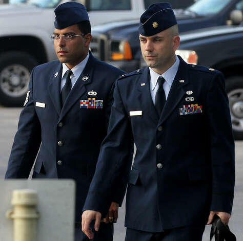 Air Force Tech Sergeant Jaime Rodriguez (left) heads for court Thursday June 6, 2013 at Joint Base San Antonio-Lackland. He is accused of having illicit contact with 18 women, and having sex with four of them. Photo: SAN ANTONIO EXPRESS-NEWS / ©San Antonio Express-News