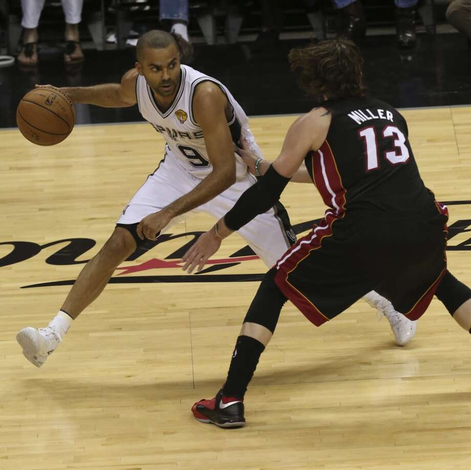 Tony Parker drives around the  Miami Heat's Mike Miller during the first half of Game 4 of the NBA Finals at the AT&T Center on Thur., June 13, 2013. (Jerry Lara/San Antonio Express-News)
