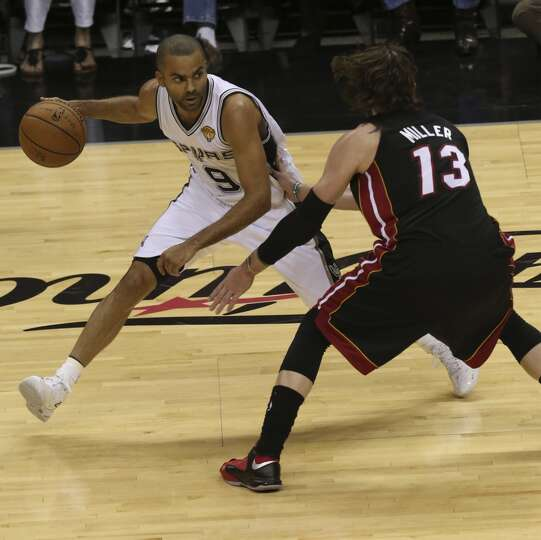 Tony Parker Drives Around The Miami Heat's Mike Miller