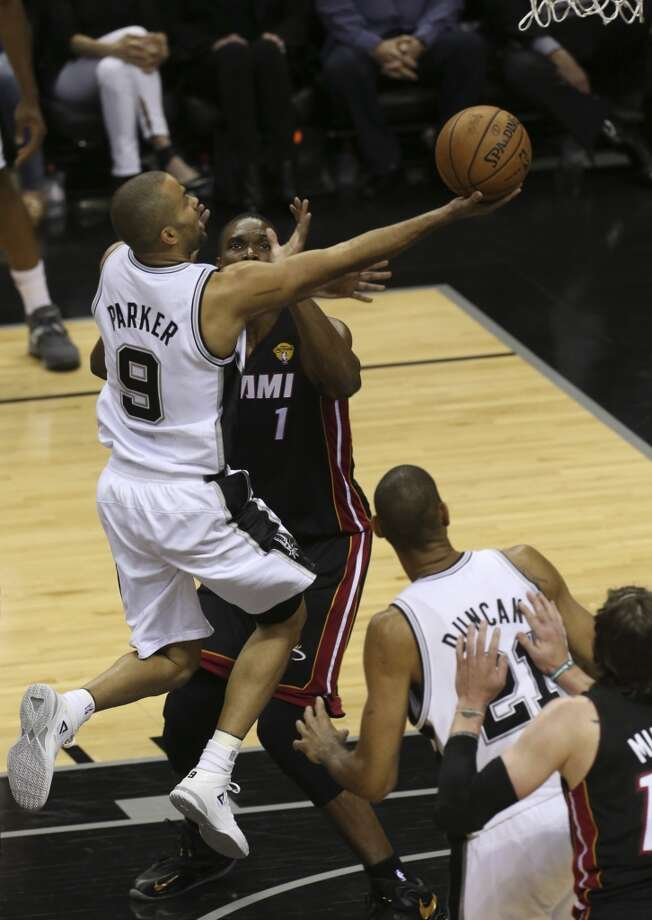 San Antonio Spurs' Tony Parker drives past Miami Heat's Chris Bosh on his way to the hoop during the first half of Game 4 of the NBA Finals at the AT&T Center on Thur., June 13, 2013. (Jerry Lara/San Antonio Express-News)