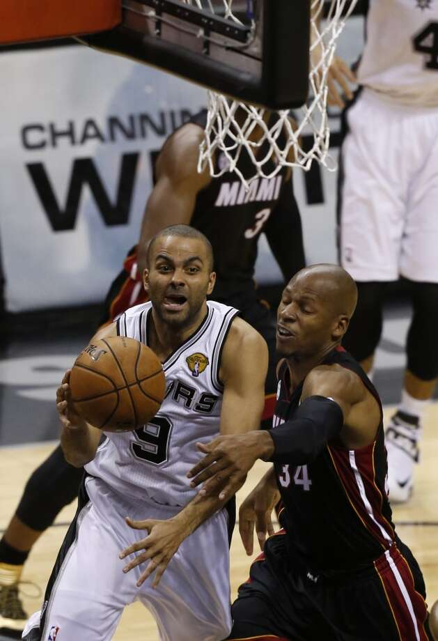 San Antonio Spurs' Tony Parker drives around Miami Heat's Ray Allen during first half action in Game 4 of the 2013 NBA Finals Thursday June 13, 2013 at the AT&T Center. (Edward A. Ornelas/San Antonio Express-News)