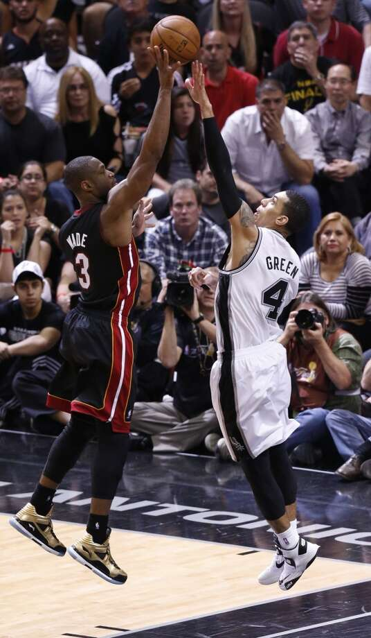 San Antonio Spurs' Danny Green defends Miami Heat's Dwyane Wade during first half action in Game 4 of the 2013 NBA Finals against the Miami Heat Thursday June 13, 2013 at the AT&T Center. (Edward A. Ornelas/San Antonio Express-News)