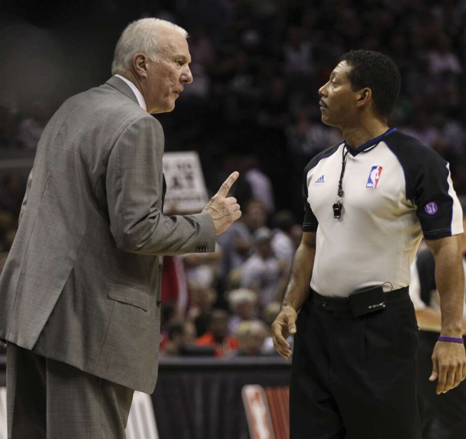 Spurs coach Gregg Popovich, left, talks to referee Bill Kennedy during the first half of Game 4 of the NBA Finals at the AT&T Center on Thursday, June 13, 2013. (Kin Man Hui/San Antonio Express-News)