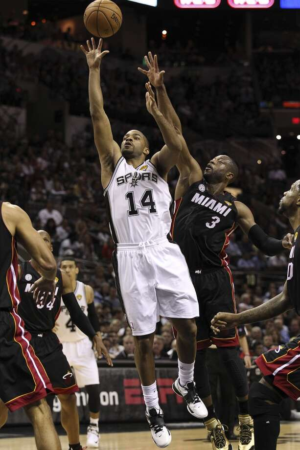 San Antonio Spurs' Gary Neal takes a shot against Miami Heat's Dwyane Wade during the first half of Game 4 of the NBA Finals at the AT&T Center on Thursday, June 13, 2013. (Kin Man Hui/San Antonio Express-News)