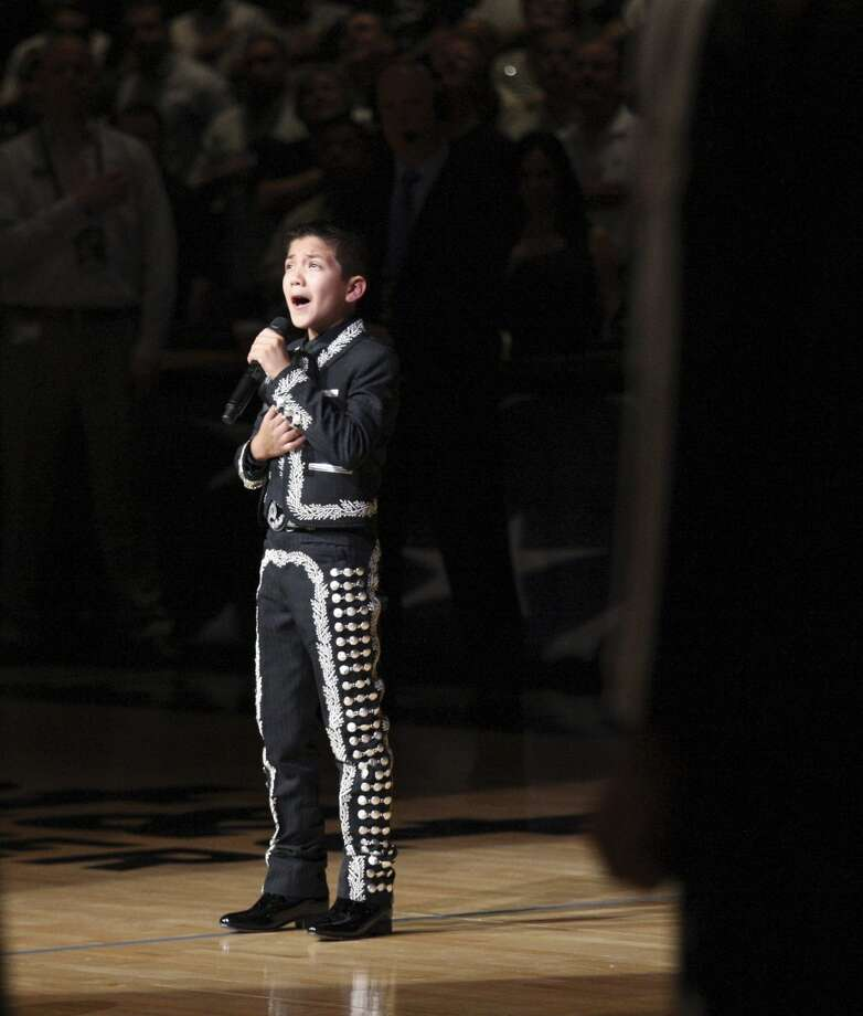Sebastien De La Cruz sings the national anthem before the start of Game 4 of the 2013 NBA Finals Thursday June 13, 2013 at the AT&T Center. (Edward A. Ornelas/San Antonio Express-News)