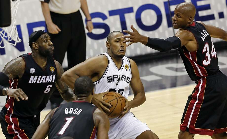 San Antonio Spurs' Boris Diaw looks for room between Miami Heat's LeBron James, Chris Bosh, and Ray Allen during first half action in Game 4 of the 2013 NBA Finals aThursday June 13, 2013 at the AT&T Center. (Edward A. Ornelas/San Antonio Express-News)