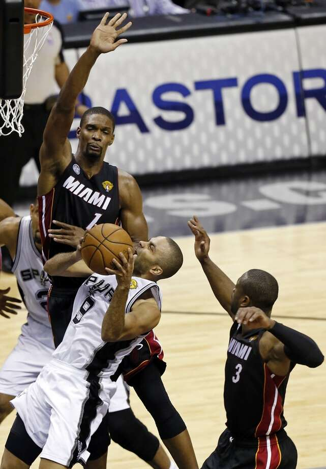 San Antonio Spurs' Tony Parker looks for room between Miami Heat's Chris Bosh, and Dwyane Wade during first half action in Game 4 of the 2013 NBA Finals Thursday June 13, 2013 at the AT&T Center. (Edward A. Ornelas/San Antonio Express-News)