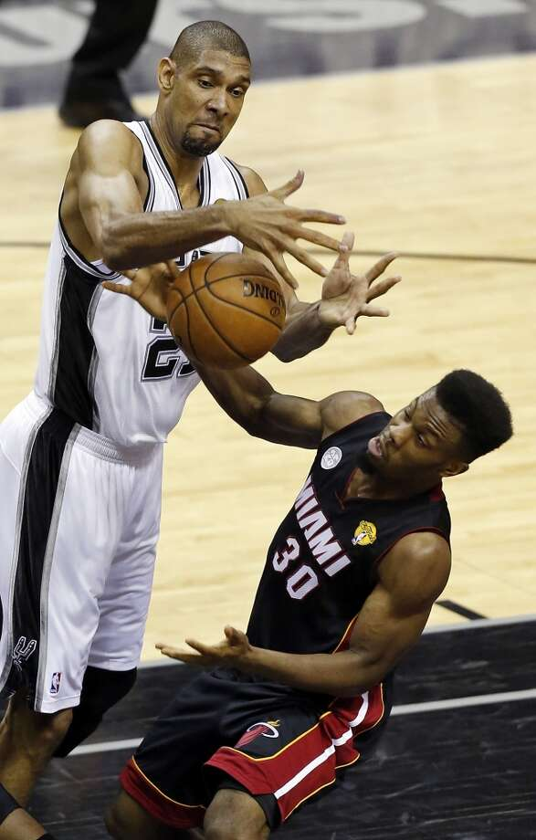 San Antonio Spurs' Tim Duncan grabs for a rebound over  Miami Heat's Norris Cole during first half action in Game 4 of the 2013 NBA Finals Thursday June 13, 2013 at the AT&T Center. (Edward A. Ornelas/San Antonio Express-News)