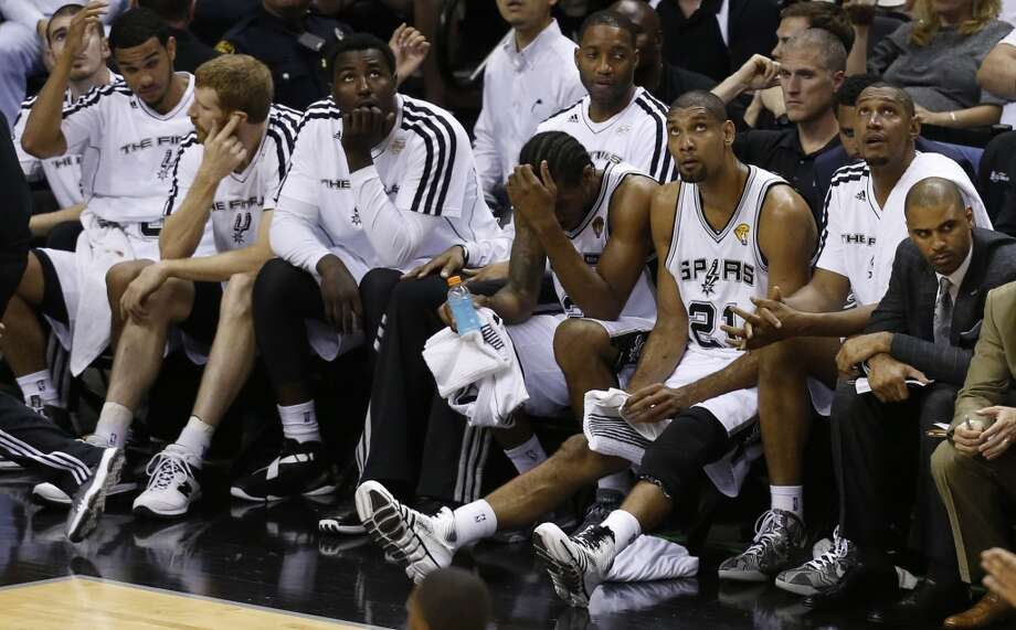 Tim Duncan watches the clock as he sits on the bench during second half action in Game 4 of the 2013 NBA Finals Thursday June 13, 2013 at the AT&T Center. (Edward A. Ornelas/San Antonio Express-News)