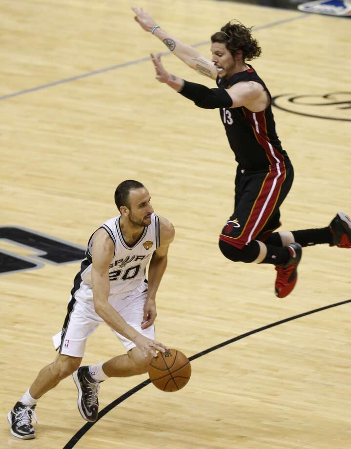 San Antonio Spurs' Manu Ginobili drives under defender Miami Heat's Mike Miller during second half action in Game 4 of the 2013 NBA Finals Thursday June 13, 2013 at the AT&T Center. (Edward A. Ornelas/San Antonio Express-News)