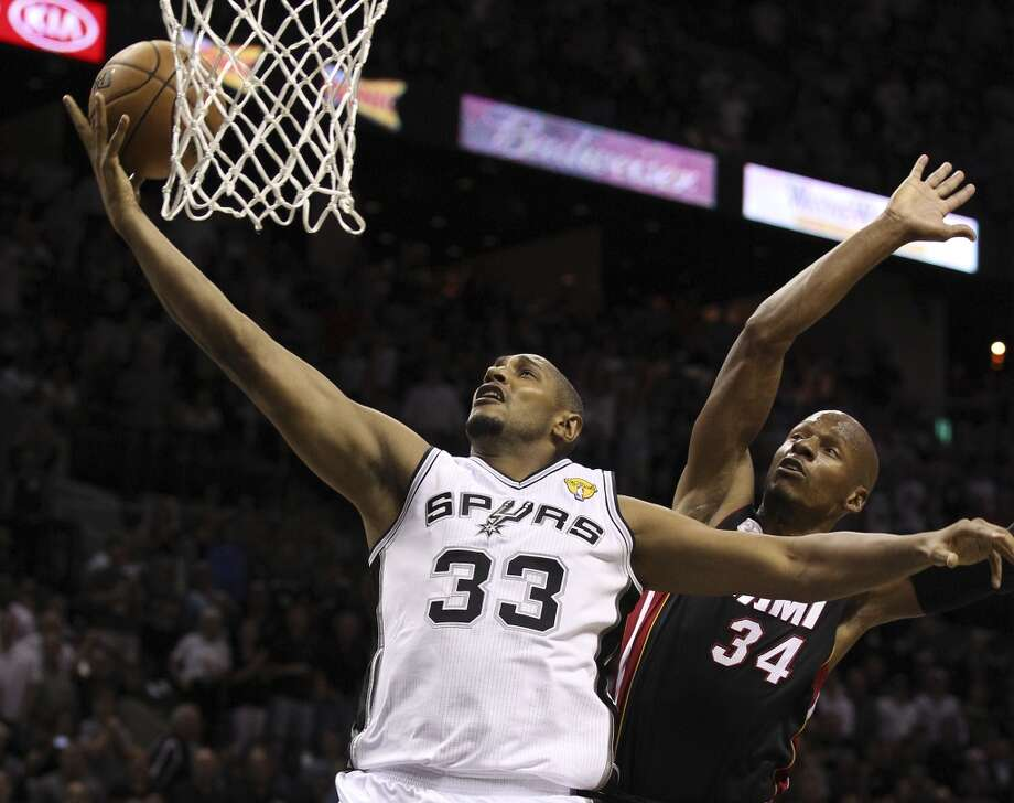 San Antonio Spurs' Boris Diaw goes for a layup against Miami Heat's Ray Allen during the first half of Game 4 of the NBA Finals at the AT&T Center on Thursday, June 13, 2013. (Kin Man Hui/San Antonio Express-News)