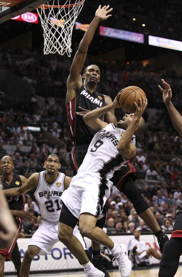 San Antonio Spurs' Tony Parker goes for a shot against Miami Heat's Chris Bosh during the first half of Game 4 of the NBA Finals at the AT&T Center on Thursday, June 13, 2013. (Kin Man Hui/San Antonio Express-News)