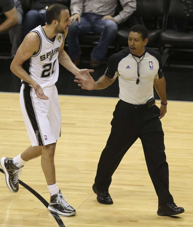 San Antonio Spurs' Manu Ginobili talks with referee Bill Kennedy after a foul call during the first half of Game 4 of the NBA Finals at the AT&T Center on Thur., June 13, 2013. (Jerry Lara/San Antonio Express-News)