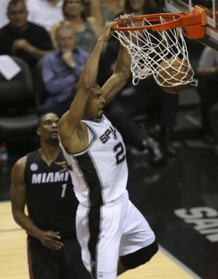 San Antonio Spurs' Tim Duncan dunks over Miami Heat's Chris Bosh during the first half of Game 4 of the NBA Finals at the AT&T Center on Thur., June 13, 2013. (Jerry Lara/San Antonio Express-News)