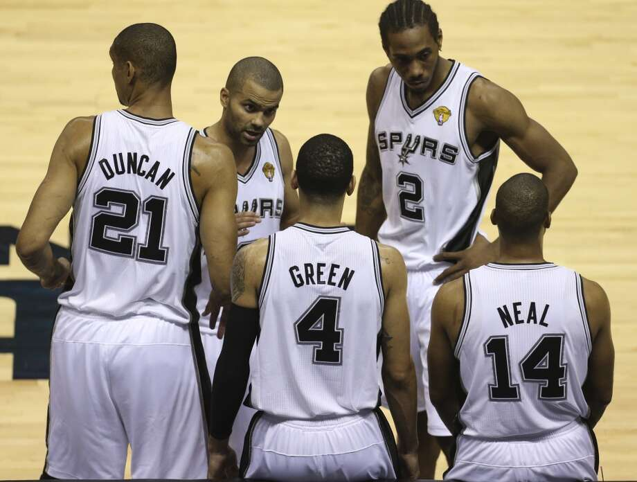 San Antonio Spurs' Tony Parker talks to Danny Green during a timeout during the first half of Game 4 of the NBA Finals at the AT&T Center on Thur., June 13, 2013. (Jerry Lara/San Antonio Express-News)