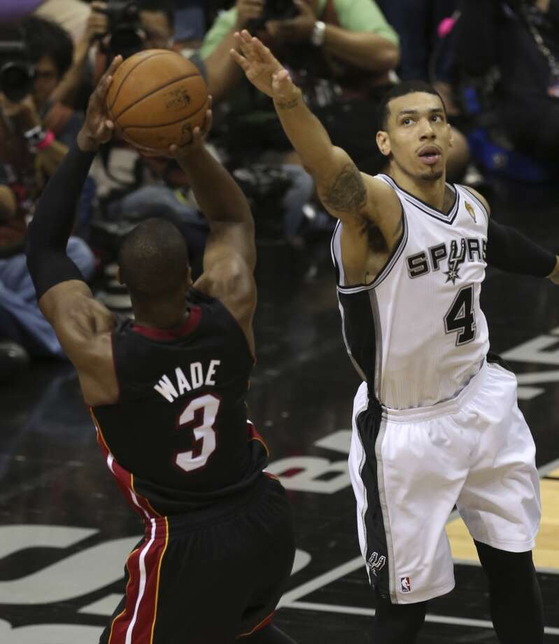 San Antonio Spurs' Danny Green defends against Miami Heat's Dwyane Wade during the first half of Game 4 of the NBA Finals at the AT&T Center on Thur., June 13, 2013. (Jerry Lara/San Antonio Express-News)