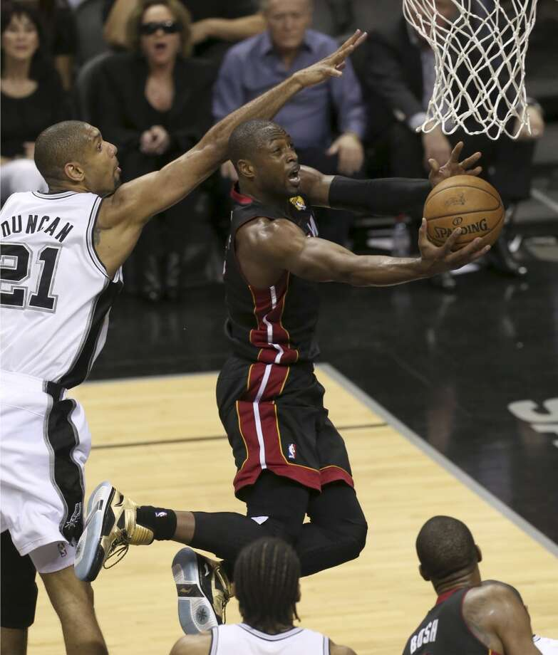 Miami Heat's Dwyane Wade drives past San Antonio Spurs' Tim Duncan on his way to the hoop during the second half of Game 4 of the NBA Finals at the AT&T Center on Thur., June 13, 2013. (Jerry Lara/San Antonio Express-News)