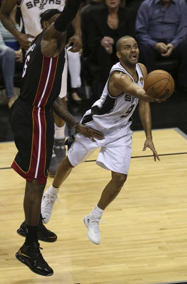 San Antonio Spurs' Tony Parker drives past Miami Heat's LeBron James during the second half of Game 4 of the NBA Finals at the AT&T Center on Thur., June 13, 2013. (Jerry Lara/San Antonio Express-News)