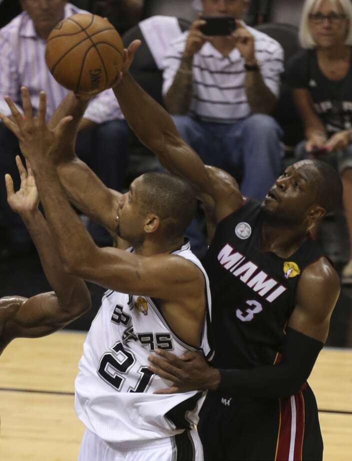 Miami Heat's Dwyane Wade wraps up San Antonio Spurs' Tim Duncan during the second half of Game 4 of the NBA Finals at the AT&T Center on Thur., June 13, 2013. (Jerry Lara/San Antonio Express-News)