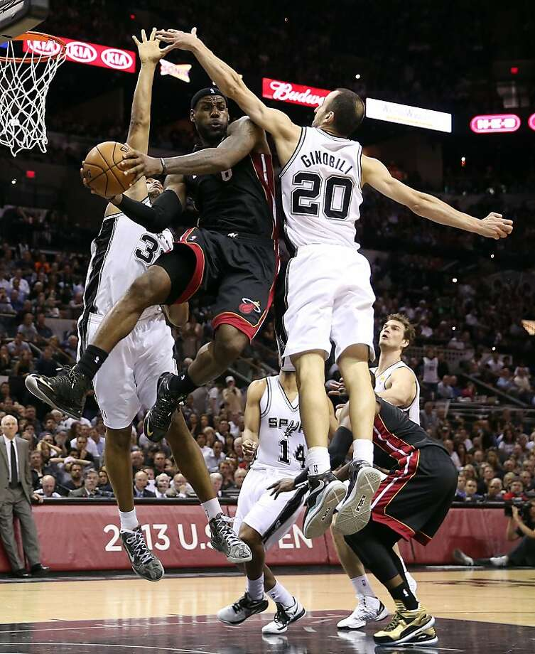 SAN ANTONIO, TX - JUNE 13:  LeBron James #6 of the Miami Heat looks to pass around Manu Ginobili #20 of the San Antonio Spurs in the fourth quarter during Game Four of the 2013 NBA Finals at the AT&T Center on June 13, 2013 in San Antonio, Texas. NOTE TO USER: User expressly acknowledges and agrees that, by downloading and or using this photograph, User is consenting to the terms and conditions of the Getty Images License Agreement.  (Photo by Christian Petersen/Getty Images) Photo: Christian Petersen, Getty Images
