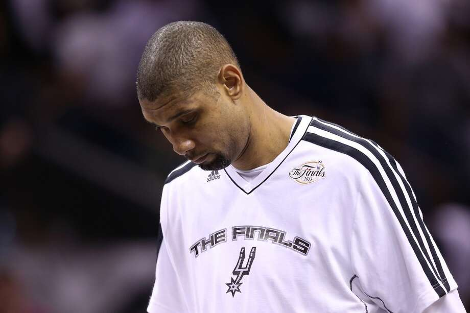 Tim Duncan walks off the court after losing to the Heat. Photo: Christian Petersen, Getty Images