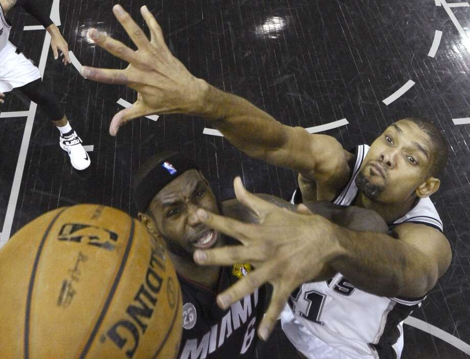 LeBron James tries to shoot against Tim Duncan. Photo: Derick E. Hingle, Associated Press