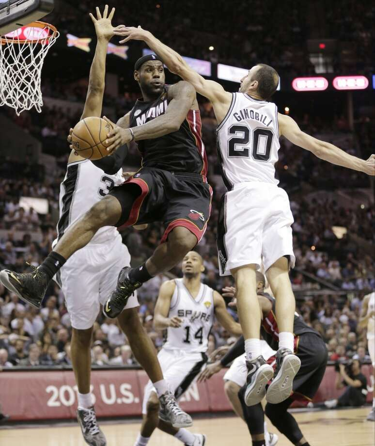 LeBron James passes between Boris Diaw and Manu Ginobili. Photo: Eric Gay, Associated Press