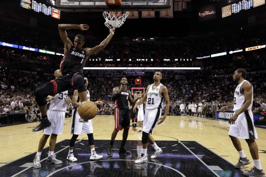 Chris Bosh dunks against the Spurs during the first half. Photo: Eric Gay, Associated Press