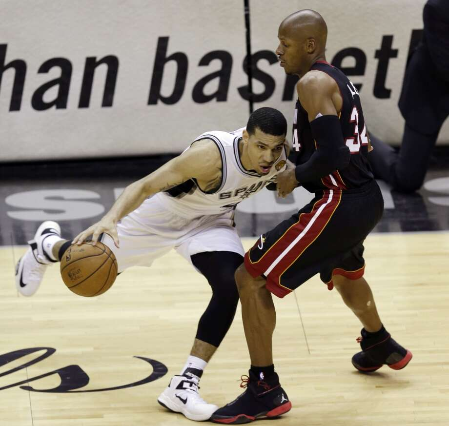 Danny Green drives against Ray Allen. Photo: David J. Phillip, Associated Press