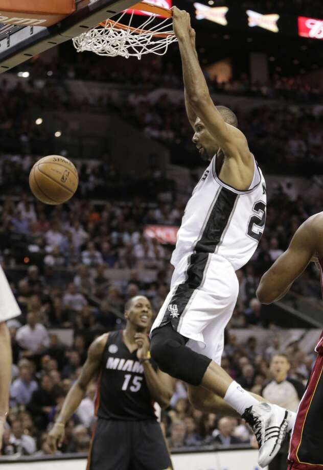 Tim Duncan dunks against the Heat during the first half. Photo: Eric Gay, Associated Press