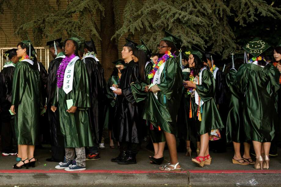 Students straighten caps and drape tassels just so before Franklin High School's graduation ceremony Thursday, June 13, 2013, at Memorial Stadium in Seattle. Photo: JORDAN STEAD, SEATTLEPI.COM / SEATTLEPI.COM