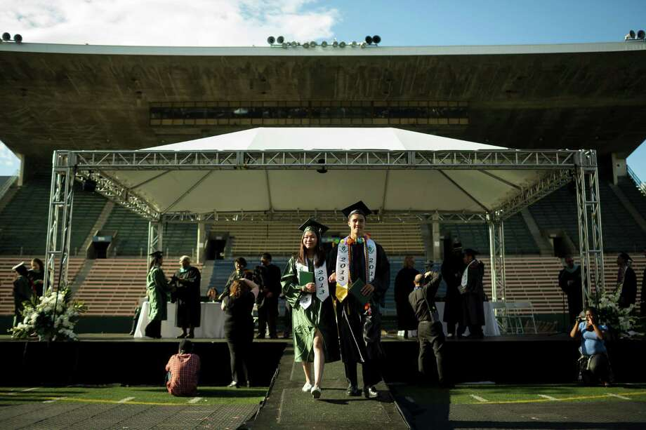 Students leave the stage after acquiring diplomas during Franklin High School's graduation ceremony Thursday, June 13, 2013, at Memorial Stadium in Seattle. Photo: JORDAN STEAD, SEATTLEPI.COM / SEATTLEPI.COM