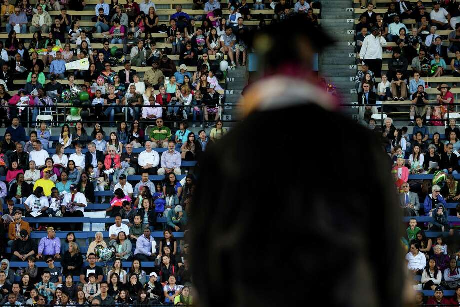Speakers take turns at the podium during Franklin High School's graduation ceremony Thursday, June 13, 2013, at Memorial Stadium in Seattle. Photo: JORDAN STEAD, SEATTLEPI.COM / SEATTLEPI.COM