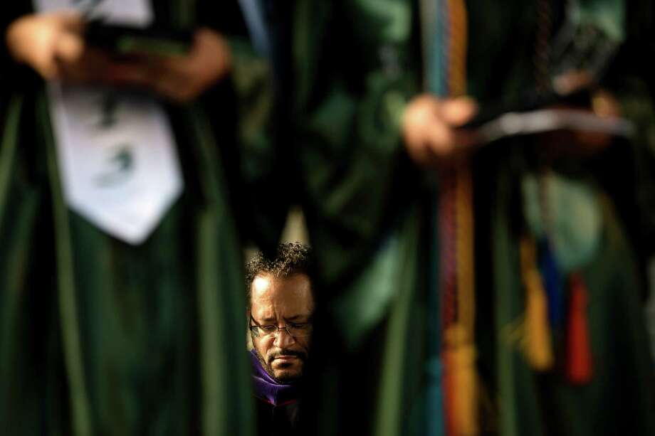 Keynote speaker Dr. Michael Eric Dyson awaits for his turn to speak to a mass of students and their families during Franklin High School's graduation ceremony Thursday, June 13, 2013, at Memorial Stadium in Seattle. Photo: JORDAN STEAD, SEATTLEPI.COM / SEATTLEPI.COM
