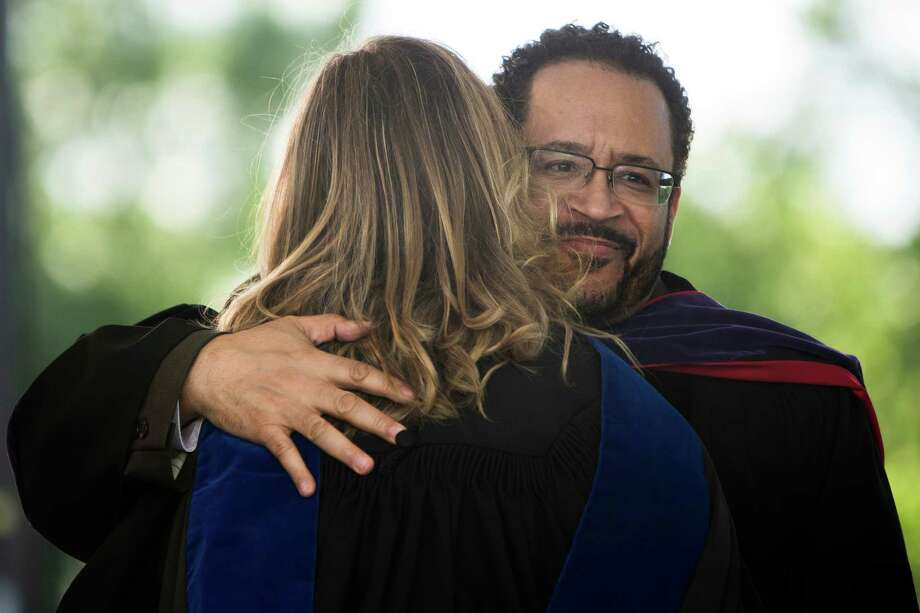 Keynote speaker Dr. Michael Eric Dyson, right, embraces Franklin High School's principal Dr. Jennifer Wiley, left, during Franklin High School's graduation ceremony Thursday, June 13, 2013, at Memorial Stadium in Seattle. Photo: JORDAN STEAD, SEATTLEPI.COM / SEATTLEPI.COM