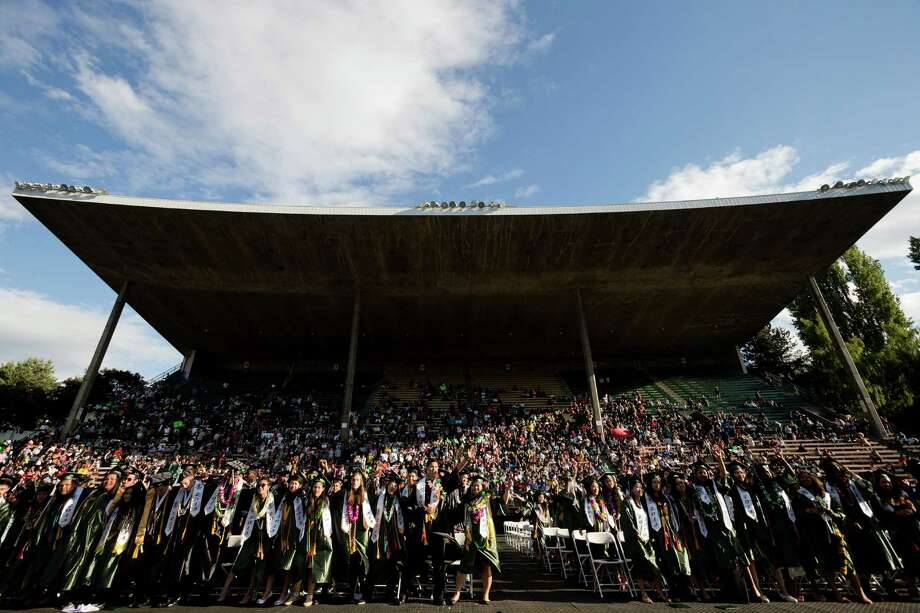 As afternoon faded into evening, family and friends packed the stands of Memorial Stadium to watch hundreds of Franklin High School students graduate Thursday, June 13, 2013, in Seattle. Photo: JORDAN STEAD, SEATTLEPI.COM / SEATTLEPI.COM