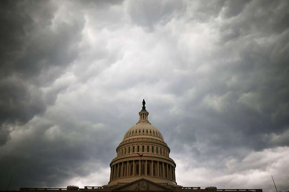 WASHINGTON, DC - JUNE 13:  Storm clouds fill the sky over the U.S. Capitol Building, June 13, 2013 in Washington, DC. Potentially damaging storms are forecasted to hit parts of the east coast with potential for causing power wide spread outages.  (Photo by Mark Wilson/Getty Images) Photo: Mark Wilson, Getty Images