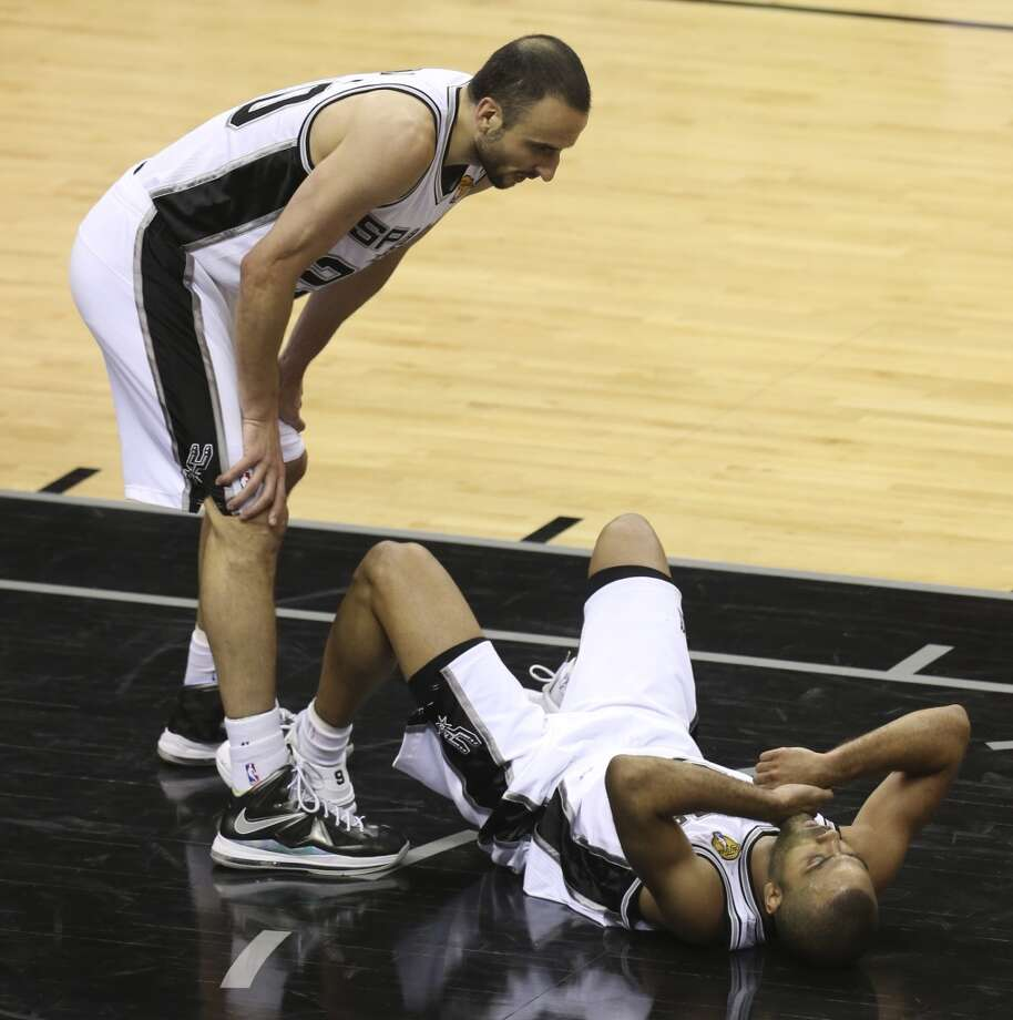 San Antonio Spurs' Manu Ginobili checks on teammate Tony Parker during the second half of Game 4 of the NBA Finals at the AT&T Center on Thur., June 13, 2013. (Jerry Lara/San Antonio Express-News)
