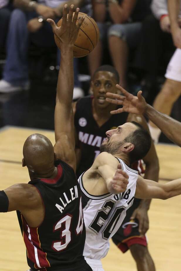San Antonio Spurs' Manu Ginobili flails as he looses the ball while under pressure from Miami Heat's Ray Allen during the second half of Game 4 of the NBA Finals at the AT&T Center on Thur., June 13, 2013. (Jerry Lara/San Antonio Express-News)