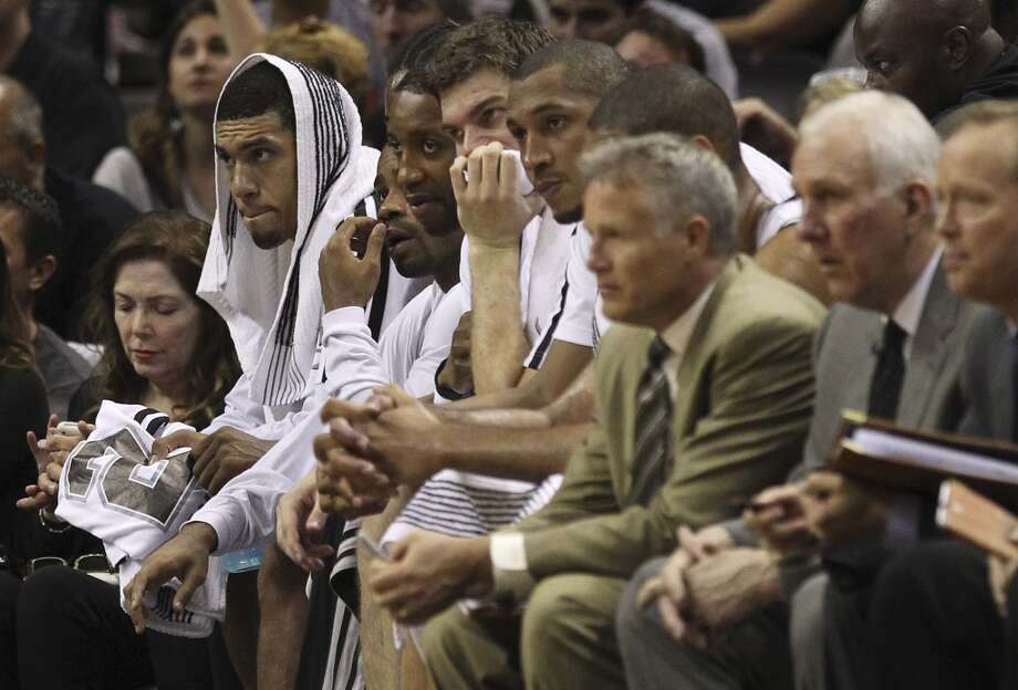 The Spurs bench appeared quiet in the closing moments of the game against the Miami Heat in Game 4 of the NBA Finals at the AT&T Center on Thursday, June 13, 2013. Heat defeat the Spurs, 109-93. (Kin Man Hui/San Antonio Express-News)