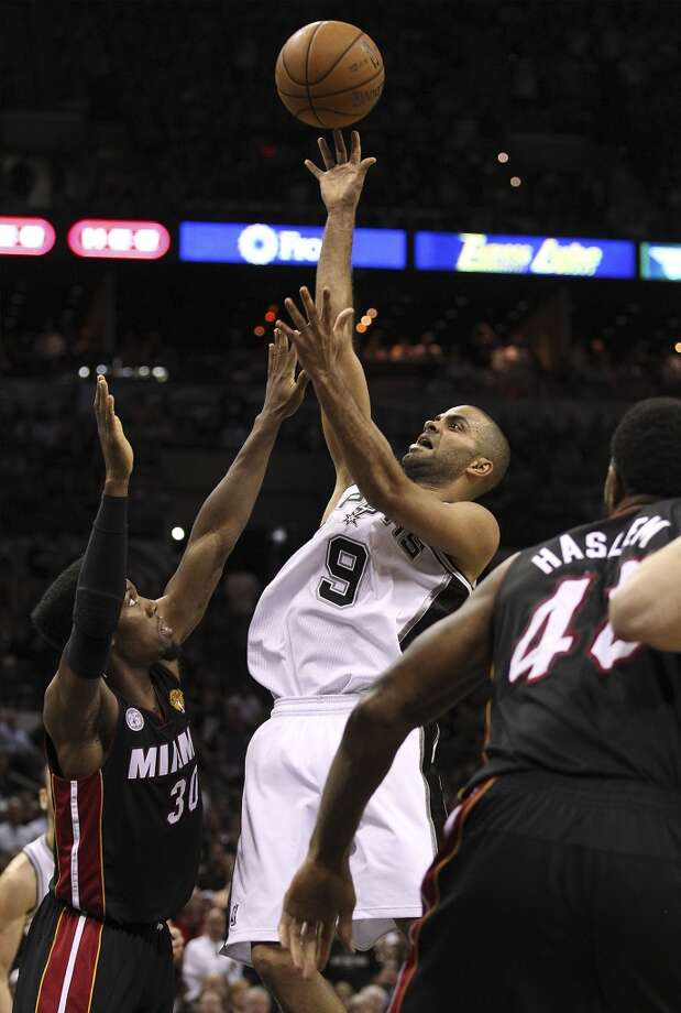 San Antonio Spurs' Tony Parker takes a shot over Miami Heat's Norris Cole during the second half of Game 4 of the NBA Finals at the AT&T Center on Thursday, June 13, 2013. (Kin Man Hui/San Antonio Express-News)