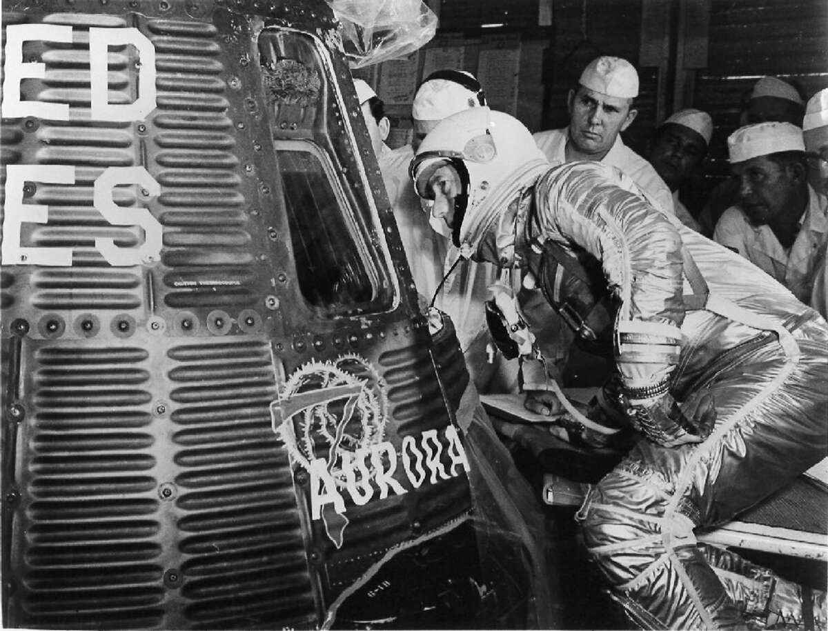 Scott Carpenter looks into Aurora 7. He was one of the original seven astronauts selected for NASA's Project Mercury in 1959. It was the first human spaceflight program of the United States.