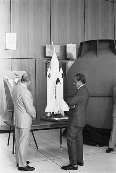 President Richard Nixon examines a space shuttle model at JSC in 1974.