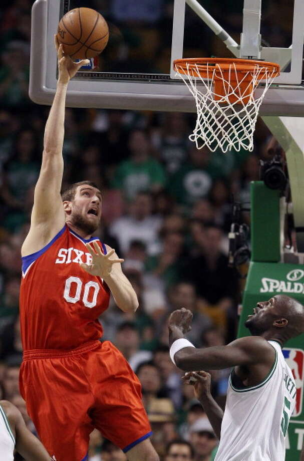 Spencer Hawes, center  Played for UW: 2006-07  Now plays for: Philadelphia 76ers (NBA)  Photo: Elsa, Getty Images / 2012 Getty Images