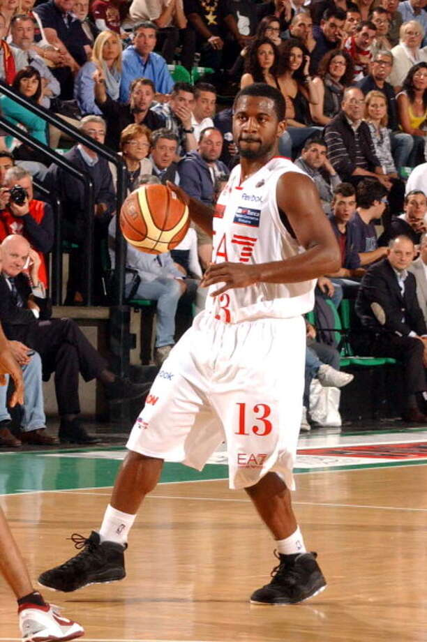 Justin Dentmon, point guard  Played for UW: 2005-09  Now plays for: Capitanes de Arecibo (Puerto Rican league)  Photo: Arturo Presotto - Iguana Press, Getty Images / 2012 Arturo Presotto - Iguana Press