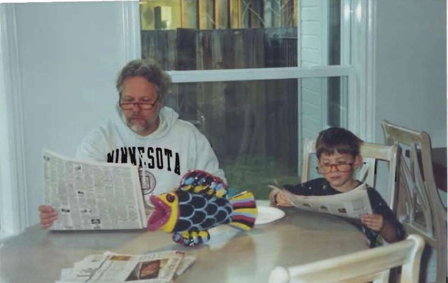 Some fathers and sons read the paper together. Photo: Pamela-mayfield