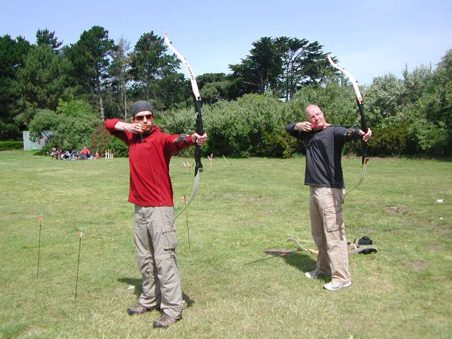 Some fathers and sons shoot arrows together. Photo: Tom-gorrebeeck