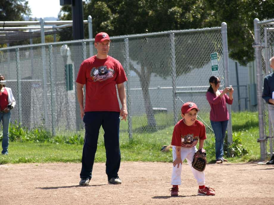 Some fathers and sons play baseball together. Photo: Meryl-bailey