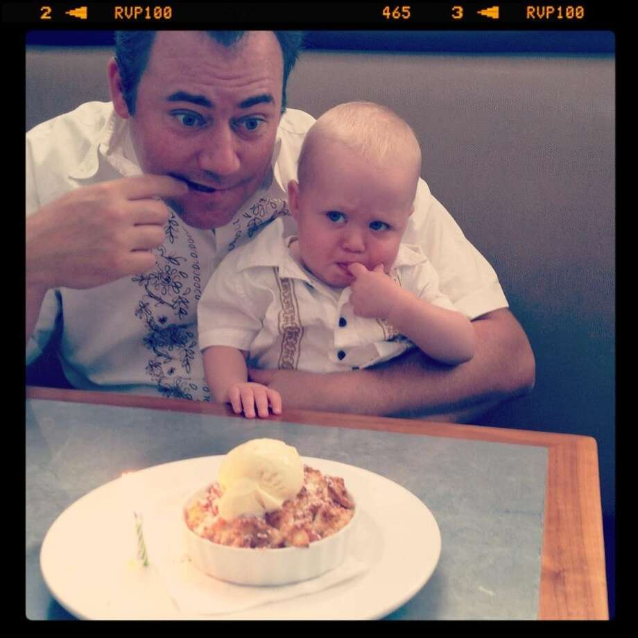 All fathers and sons enjoy eating dessert together.